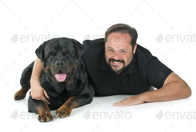 rottweiler and man in studio