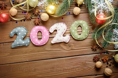 Colorful stitched digits 2020 of polkadot fabric with Christmas