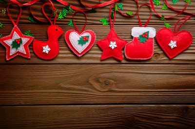 Handmade rustic red felt Christmas tree decorations flat lying o