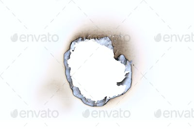 Hole burnt in a sheet of paper