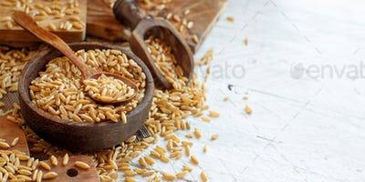 Raw Kamut grain in a wooden bowl