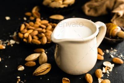 Homemade almond milk in jug. Almond milk and almonds