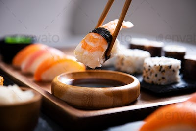 Chopstick with nigiri sushi piece