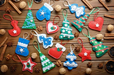 Assorted handmade rustic felt Christmas tree decorations with an