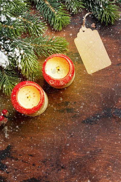 Christmas candles and fir tree branch