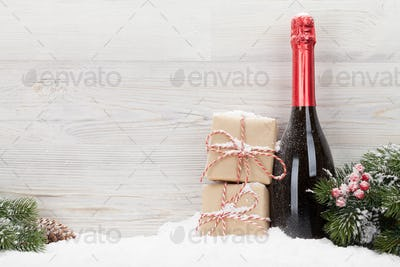 Christmas gift boxes and champagne bottle