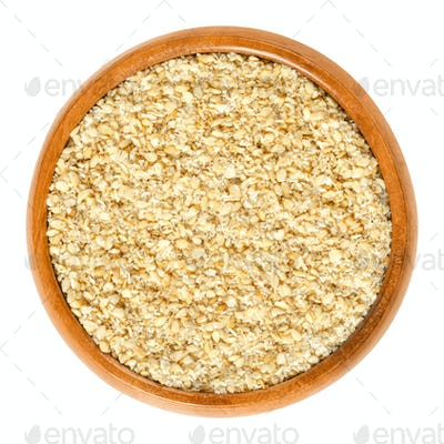 Gomashio, sesame seeds and salt, in wooden bowl