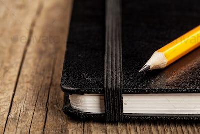 Pencil and a notebook up close