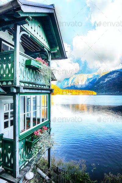 Wooden house on the coast of lake in Hallstatt village Austrian