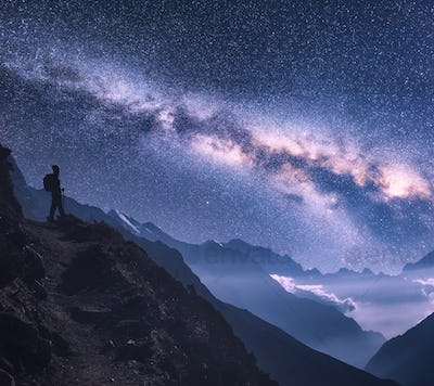 Space with Milky Way, girl and mountains at night