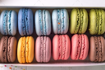 Colorful french macaroons backgrounds, flat lay. Holidays and celebrations concept.