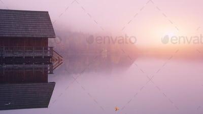 Misty sunrise on a lake Altausseer