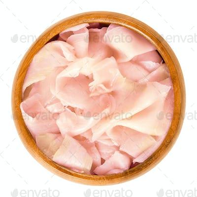 Gari, pickled sushi ginger in wooden bowl over white