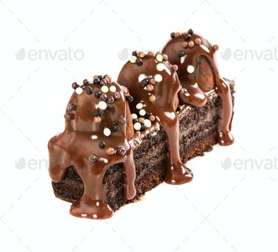 Chocolate cake with truffles poured with milk chocolate syrup