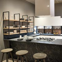 Modern kitchen interior with centre island and hob
