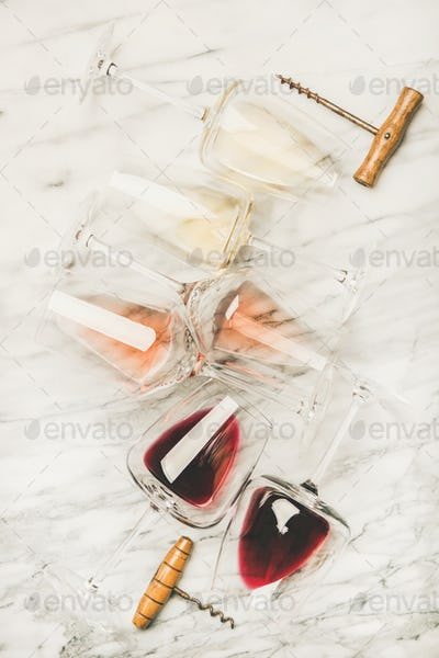 Red, rose and white wine in glasses and corkscrews