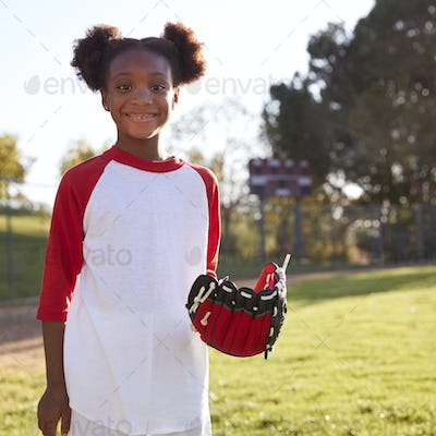 Young Black girl with baseball mitt, smiling, square format