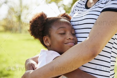 Close Up Of Mother Hugging Daughter In Park