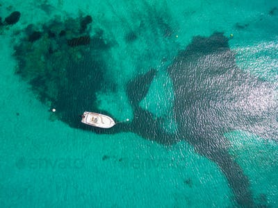 Aerial  view of a leisure boat mooring in translucent turquoise