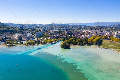 Aerial view of Annecy lake waterfront low tide level due to the