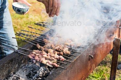 lamb kebabs on skewers, sprinkle salt