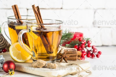 Winter hot tea with lemon and spices