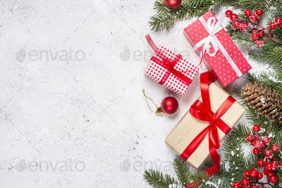 Christmas background with fir tree and present box on white