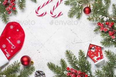 Christmas background with fir tree, gift, candle and decorations