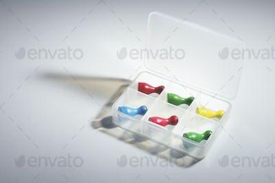 Game Pieces in Plastic Container