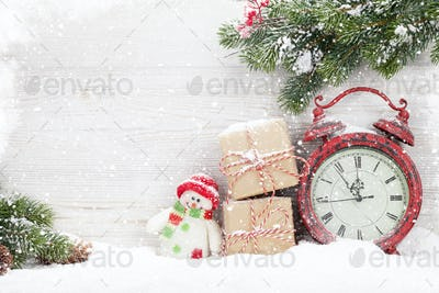 Christmas gift boxes, alarm clock and fir tree branch