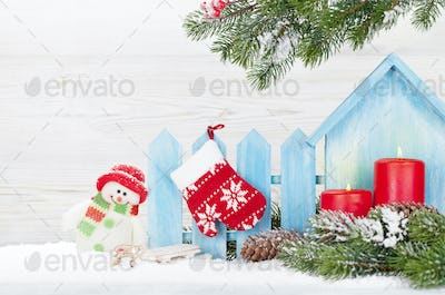 Christmas candles, snowman toy and fir tree