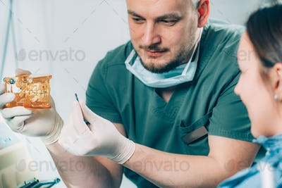 Dentist explaining dental implant procedure to patient