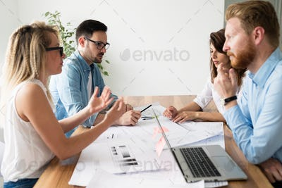 Group of architects and designers working and collaborating on project