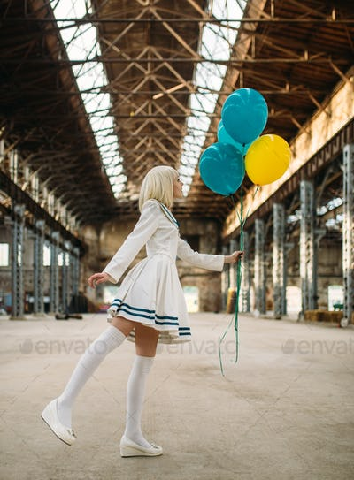Anime style girl poses with colorful air balloons