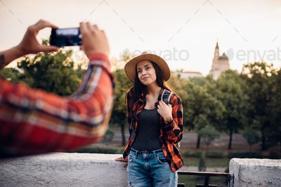 Young woman poses on excursion in tourist town