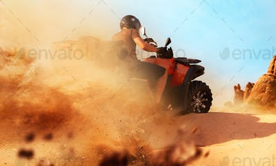 Atv riding in sand quarry, dust clouds, quad bike