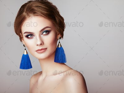 Beautiful Woman with Large Earrings Tassels
