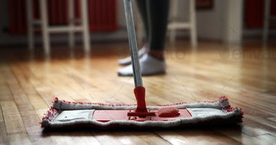 Woman using mop cleaner to do household chores faster