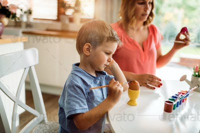 Mother and son paint Easter eggs