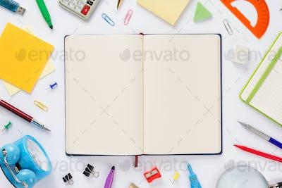 school accessories and open notebook