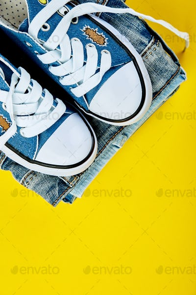 Blue female or male sneakers and jeans