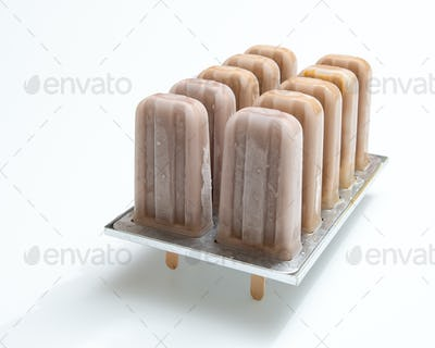 Cold chocolate dessert on a stick in plastic form on a white background with copy space. Ice cream