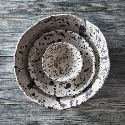 Clay handcraft empty gray bowls, covered with glazed a gray wooden background with copy space. Flat