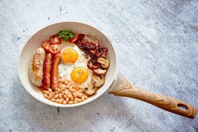 Traditional Full English Breakfast on frying pan.