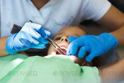 Child to the dentist. Child in the dental chair dental treatment