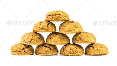 Pyramid shape of traditional pepernoten treats on white backgrou