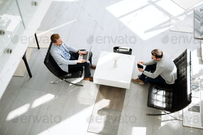 Business meeting in lobby