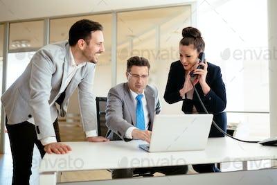 Secretaries assisting boss at business