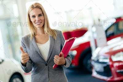 Professional salesperson in car dealership
