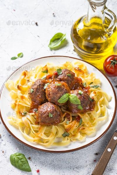 Meatballs in tomato sauce with pasta tagliatelle